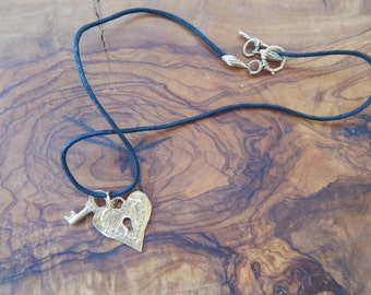 Darling gold heart and key necklace in leather rope