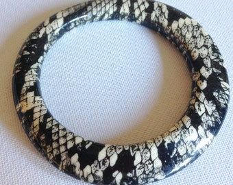 cream and black asymmetric chunky plastic bangle with snake skin effect