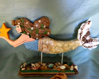 Blonde sea shelled mermaid on sea shell stand_beach decor mermaid_beach home decor