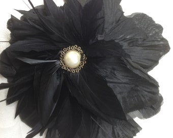 Black flower and feather fascinator