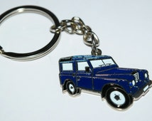 Blue Land Rover Keyring. Collectible, gift idea, present. Novelty Enamel Keyring.