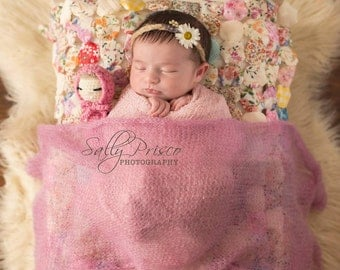 Crochet baby doll with bonnet and bow tieback