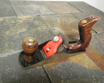 vintage WOOD WORKING  PLANE : 2 in. wide by 8 3/4 in.  made in Germany. wood handle