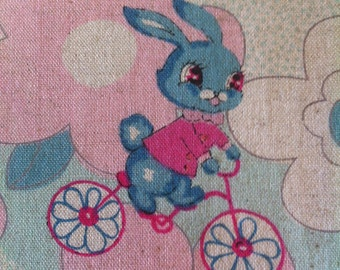 Japanese bunnies on bikes cotton linen fabric by the 1/2m
