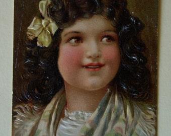 Antique girl embossed postcard