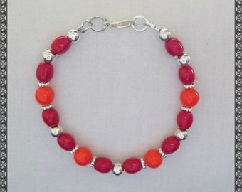 bright orange, orange and red bracelet, red bracelet, red and orange, bright orange, bright red