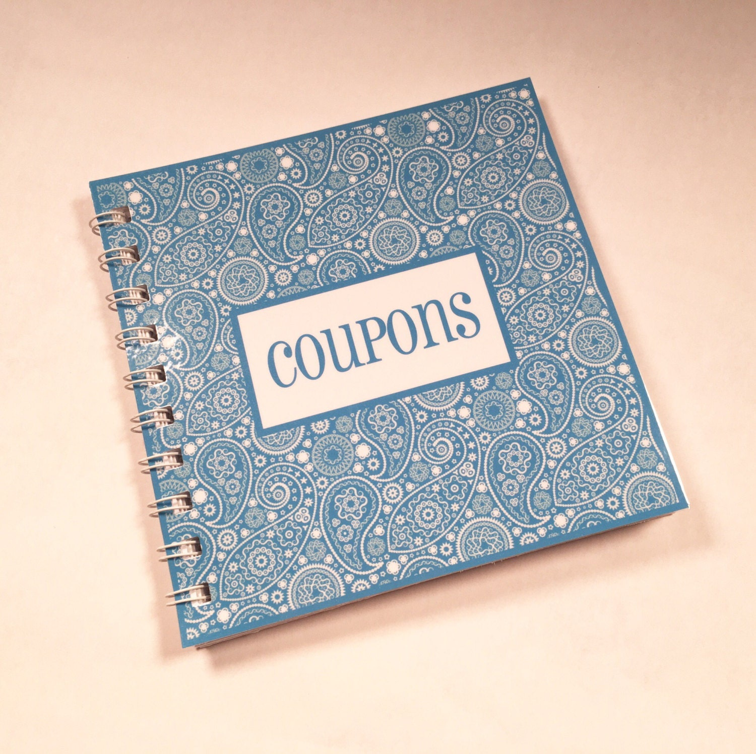 SMALL COUPON ORGANIZER. These small organizers can be found for $1 – $2 at many stores, including Dollar General, Target, and Walmart. There are usually anywhere from 6 – 10 sections within the case, so you can organize your coupons. There are also tabs where you can add labels to help you find the ones you need.