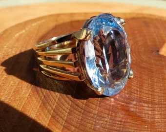 A vintage 9K yellow gold large oval watery blue topaz ring