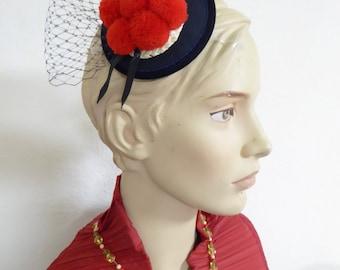 BOLLENHUT - Black Forest, red pompom hat on fascinator with veiling
