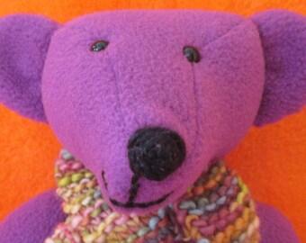 HEATHER: A funky fleece Fiesta bear,soft and plummy purple.