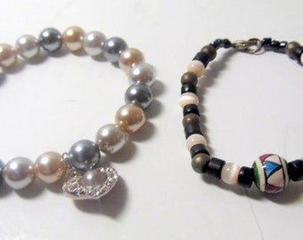 Pair of stretchy beaded bracelets, 1 with heart charm, and 1 with hand painted southwest bead