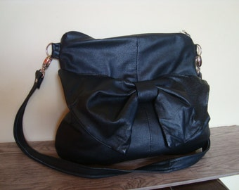 leather handbag decorated with a bow /// recycled leather