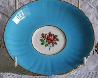Royal Grafton Saucers, bone china , bright blue with rose decoration