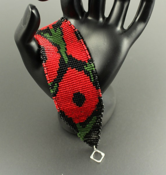 Red Poppies...Loomwoven Delica Seed Bead Bracelet/Cuff.Reds, Green and Black.Tapered Ends.Silver Toggle Clasp