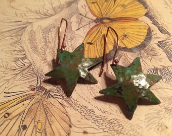 copper star earrings with a green patina