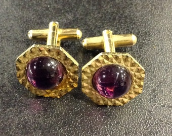 Gold cufflinks with purple stones