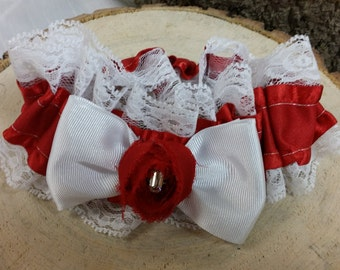 Garter white lace and red ribbon with bow and rosette