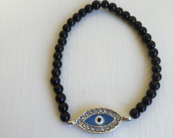 Silver and blue evil eye bracelet with black band