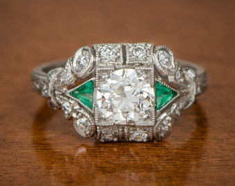 1.10ct Diamond Engagement Ring with emeralds on either side. Estate Engagement Ring. Handmade platinum.