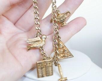 Vintage c1960S 12K Gold Filled Charm Bracelet Dove Bible Hammer Lamp Pyramid