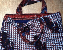 African wax print cotton shopping bag strong colourful mixed prints in dark blue, russet deep red,  bright striking traditional waxprint