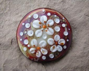 "Lampwork glass cabochon handmade by Glassartist I. Linde  ""Blossom"""