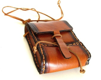 Brown leather bag.