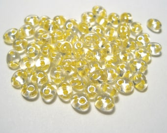 10 Grams Yellow-lined Clear Terra Preciosa Twin Seed bead Czech glass Bead 5x2.5mm oval with 2 holes