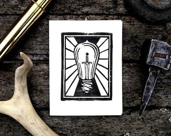 Lightbulb & Sword Block Print Greeting Card