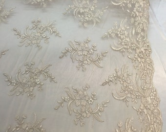 Champagne hibiscus flower design embroider and corded on a mesh lace -yard