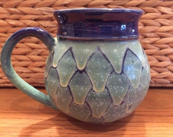 blue and green wax resist glazed mugs