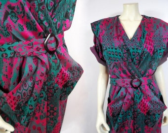 80s Avant Garde Dress, Knit Sweater Bib Sheath Fuchsia Green Black Short Sleeve Modern V Neck Belted Dress Back Slit Pockets Abstract Print