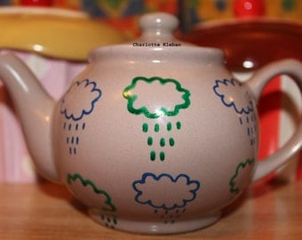 Hand drawn grey porcelain teapot with rain clouds pattern in two sizes