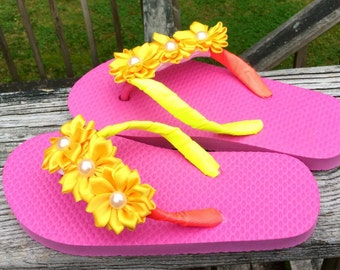 Two-Toned Yellow & Neon Pink Kids Small 11/12 Ribbon Wrapped Flower Flip Flops. Yellow/Neon Pink/Flowers/Two-Toned