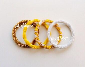 Nepal Beaded Roll On Bracelets Set of 4 Gift Birthday Yellow Gold White