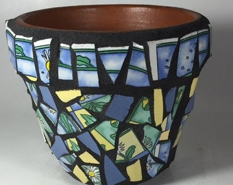 Mosaic pot in blue, green and yellow.