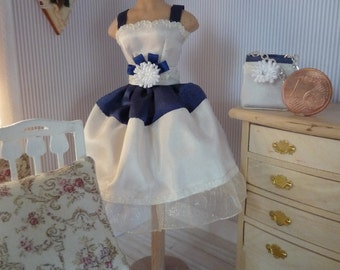 Blue/white party dress with pochette on mannequin