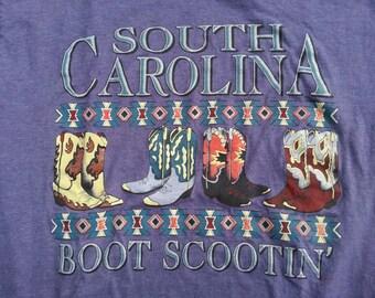 size L South Carolina Boot Scootin' cowboy boots w sparkles state souvenir purple vtg 90s tee / americana eastern western