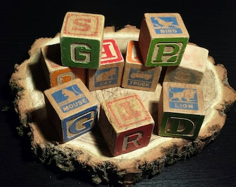 Vintage small wooden blocks. Well used, great for decorating and vintage decor. Set of 14