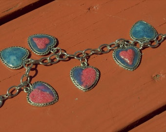 Bracelet with heart shaped pendants and polymer clay