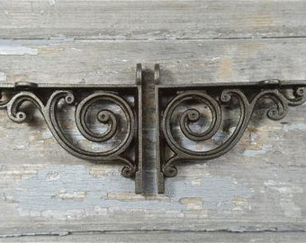 A pair of small Victorian style scroll brackets V1