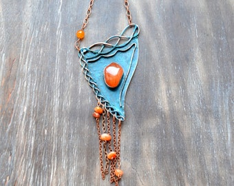 Bright necklace with carnelian, blue patina, orange and blue, asymmetry, a triangle, an asymmetric triangle