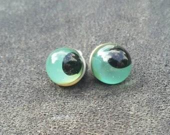 water, blue-green, turquoise eyes, beautiful glass eyes, animal eyes,.