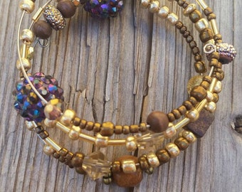 Gold beaded wire slinky bracelet.