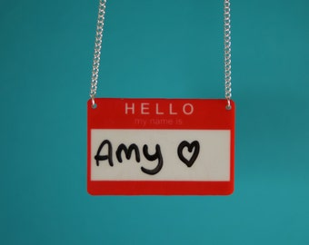 Acrylic drywipe 'Hello my name is' necklace.