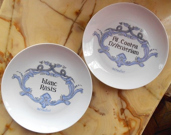 Two French vintage pharmaceutical design porcelain plates by Tharaud, Limoges