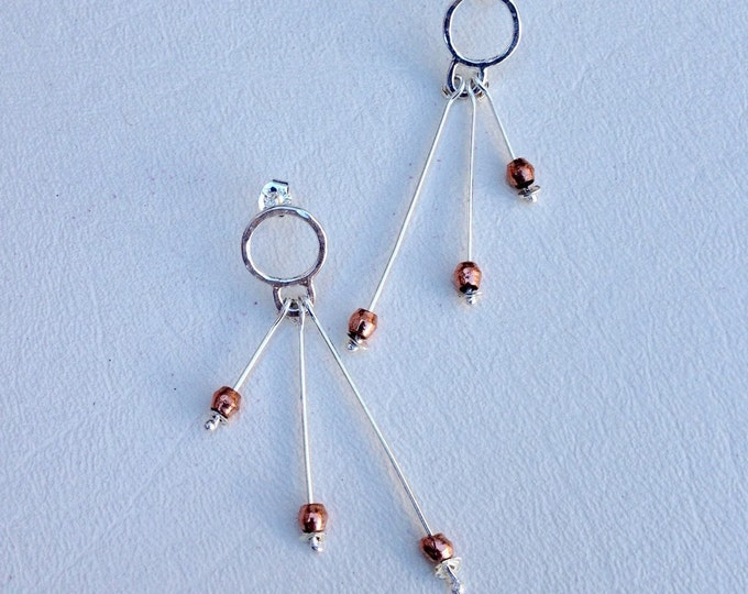 Unique handmade earrings using Sterling silver and copper
