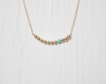 Handmade delicate gemstone necklace. Gold filled and Turquoise beads on a 14kt gold filled chain.