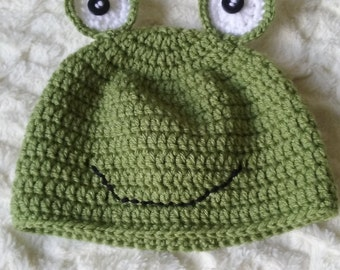 Green beanie hat in frog design for toddlers three to five years old