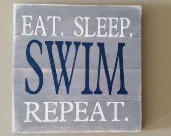 Eat Sleep Swim Repeat sign